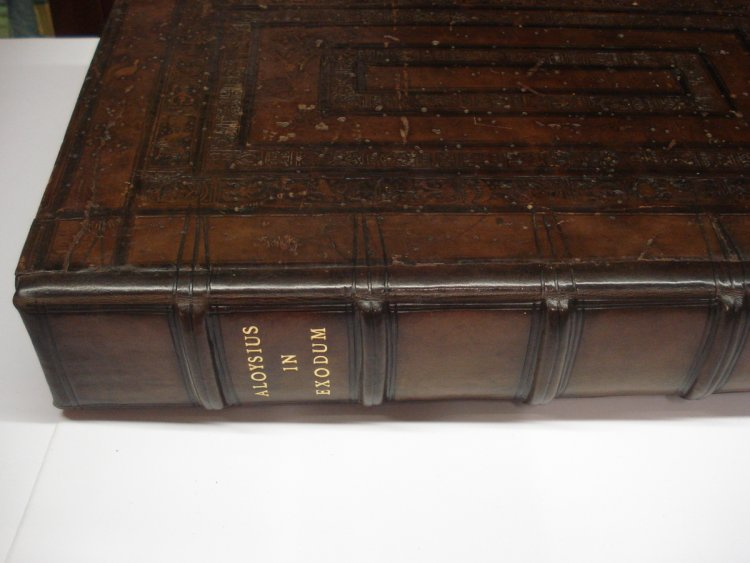 A large 16th Century book with oak boards rebacked in Calf