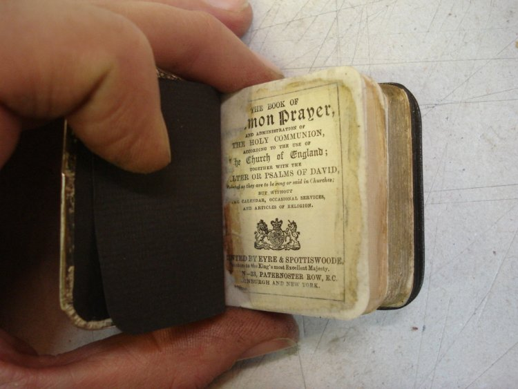 Miniature Common Prayer showing repaired pages